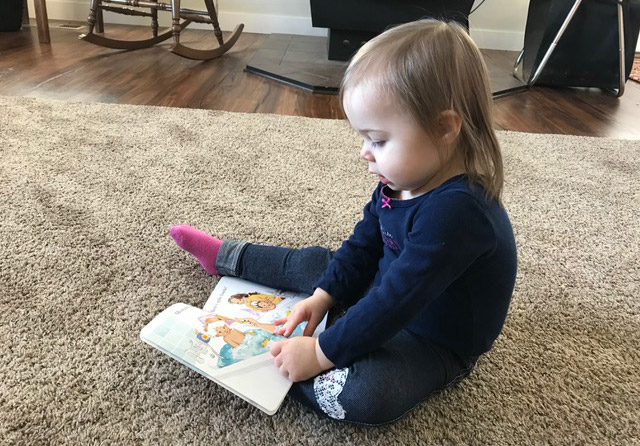 Idaho North Central Public Health District resident learns to read through District ECD program.